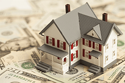 Image of a House on Stack of Cash - Tampa Real Estate - Flip Side Realty By Design